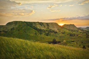 Sunset behind the hills in the North Dakota Badlands.