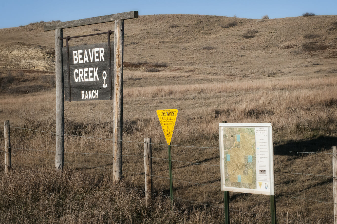Beaver Creek Ranch sign, PLOTS sign and map