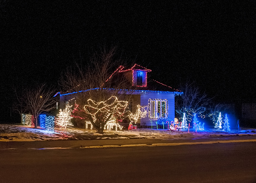 One of two homes across from each other in Belfield light up the neighborhood.