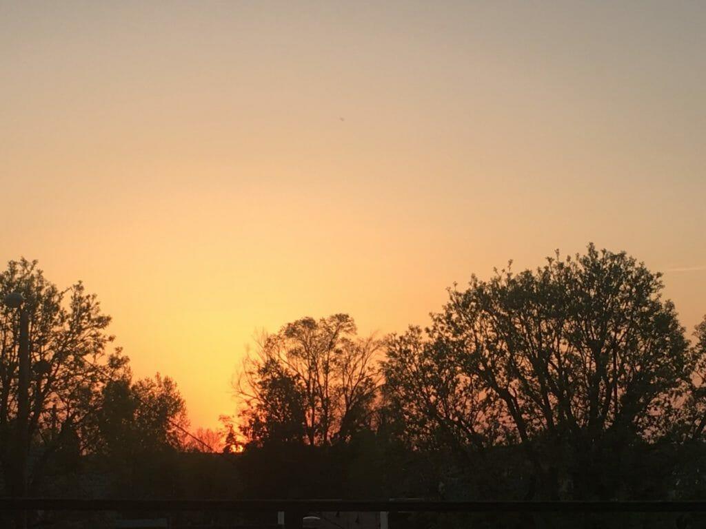 An orange sunset over Sidney, Montana riding the badlands