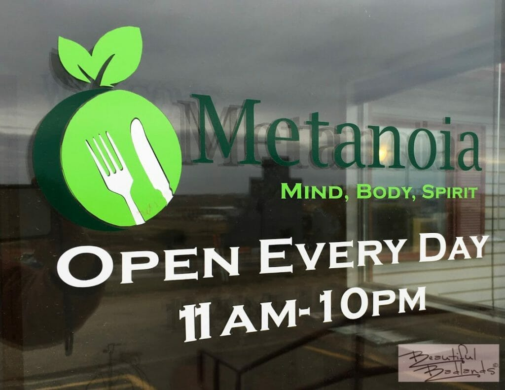 The bright logo on the front door of Metanoia Restaurant captured our attention.