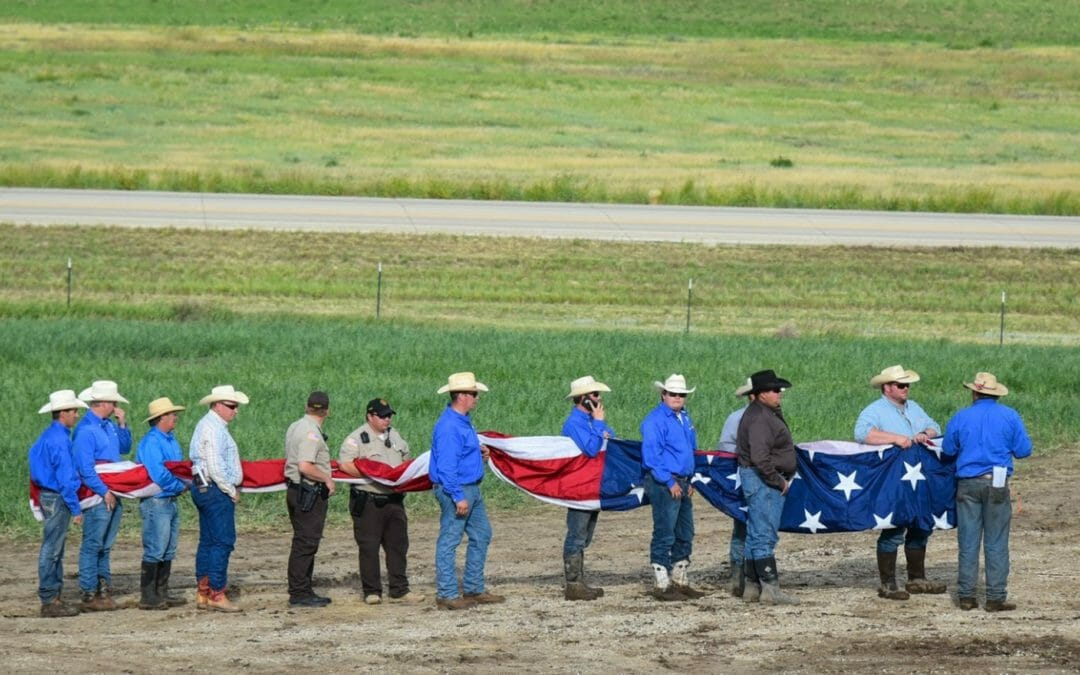 Cowboys Carry A Huge American Flag At The Rodeo!  Killdeer, North Dakota