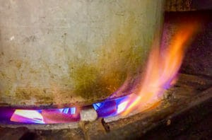 A Hot Fire Cooks Kettle of Glogg for a Holiday Celebration
