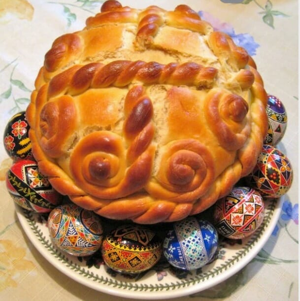Traditional Easter Bread, Panska, displayed with exquisite Ukrainian Easter eggs.