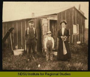 Hannah Hylden in front of her homestead tar paper shack, Arnegard, McKenzie County, North Dakota.