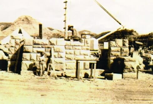 Men building east entrance from stone