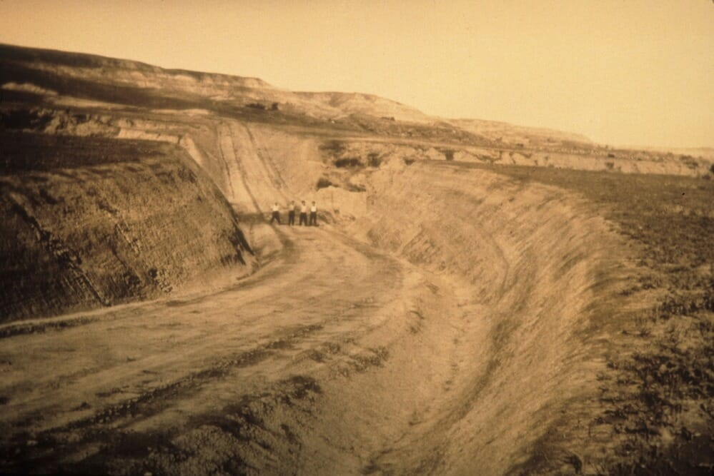 Men standing in road bed at Theodore Roosevelt National Park