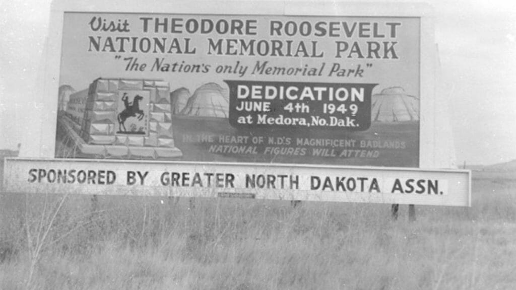 black and white photo of billboard for dedication ceremonies of Theodore Roosevelt National Memorial Park. June 4, 2019