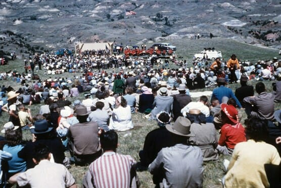 color photo of crowd at 1949 dedication of Theodore Roosevelt National Memorial Park