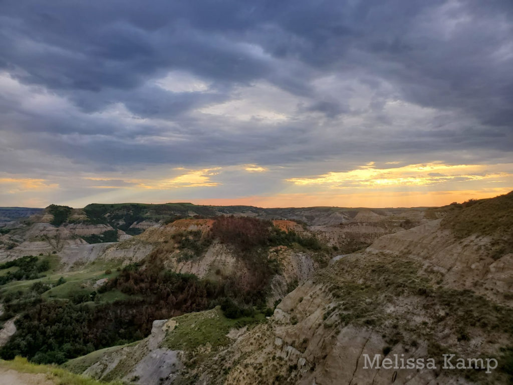Sunset and Clouds in Theodore Roosevelt National Park, North Unit. Photo by Melissa Kamp