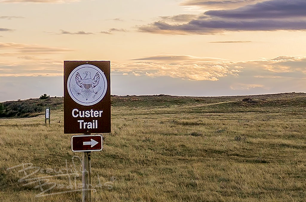 custer trail sign at sunset