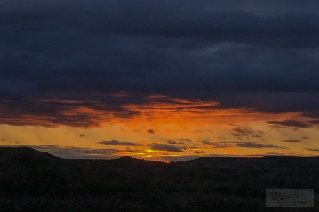 A dull day turned into vibrant flaming color as we looked west after a climb to the top of a hill overlooking Peaceful Valley Ranch in Theodore Roosevelt National Park in North Dakota.