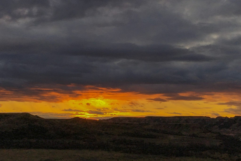The Horizon was Brilliant at sunset on the First Day of November, 2019 in the Beautiful Badlands of North Dakota